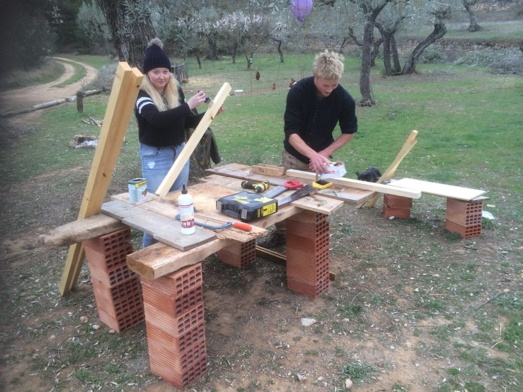 Sarah from Scotland & Ciaran from Ireland helping us build a mobile chicken coop
